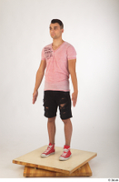 Colin black shorts clothing pink t shirt red shoes standing whole body 0002.jpg