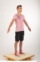 Colin black shorts clothing pink t shirt red shoes standing whole body 0016.jpg