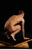 Claudio  1 kneeling nude tattoo whole body 0004.jpg